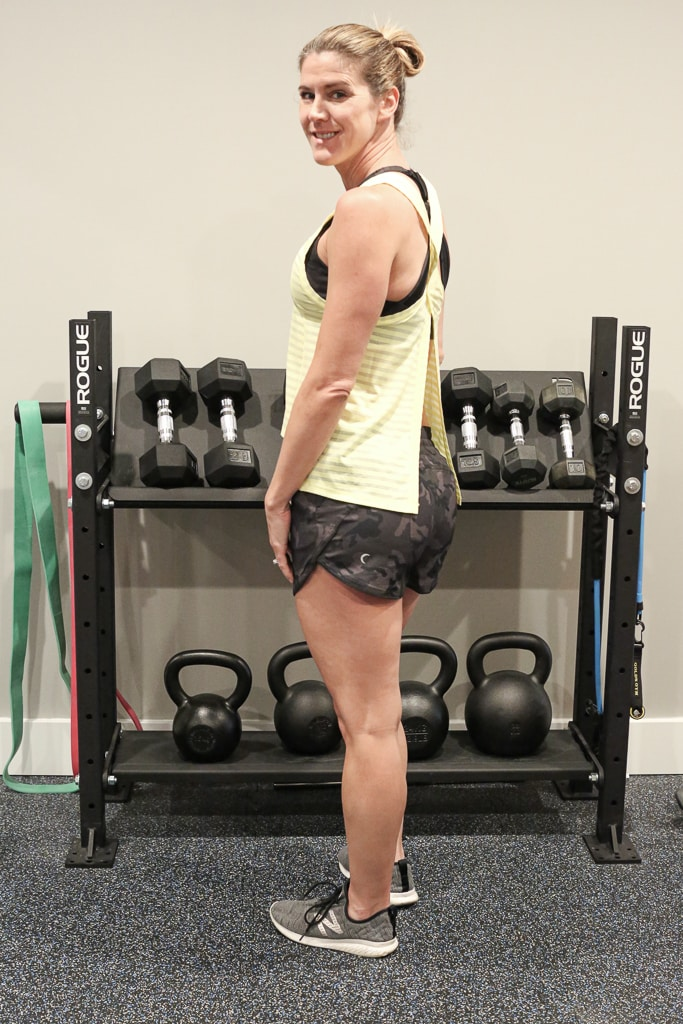a woman wearing ZYIA Active shorts and tank top