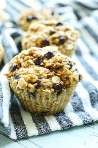 a close up picture of Peanut Butter Chocolate Chip Baked Oatmeal Muffin Cup with a striped napkin underneath