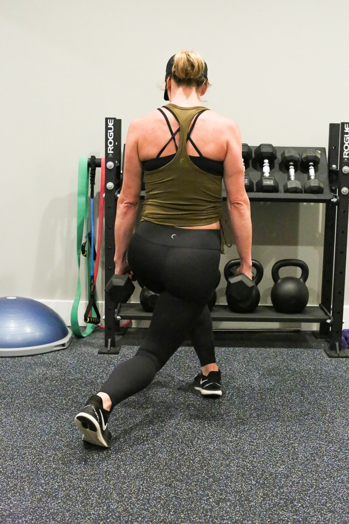 a woman performing cross behind lunges