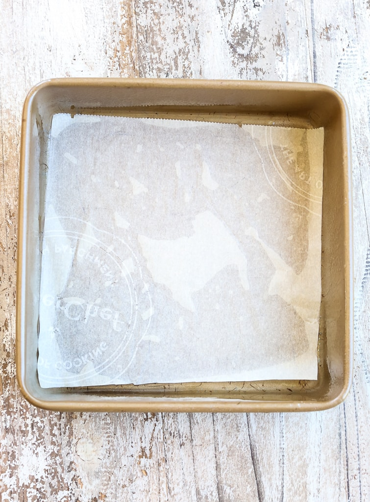 a square baking pan with parchment paper