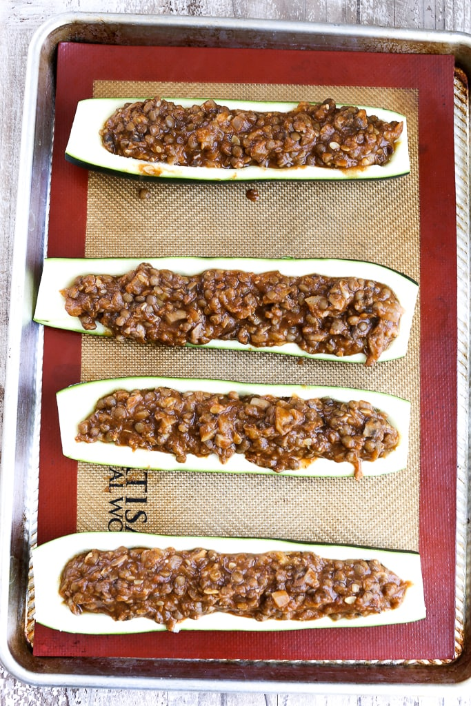 zucchini boats filled with lentil taco mixture