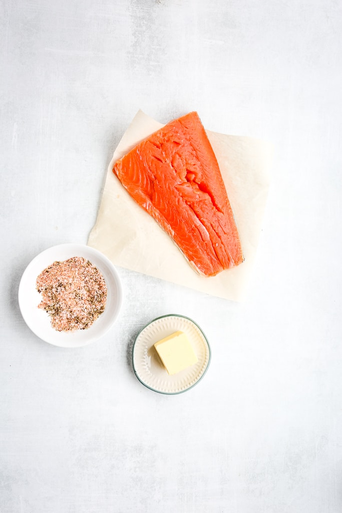 ingredients for pan fried salmon, salmon filet, butter, seasoning blend