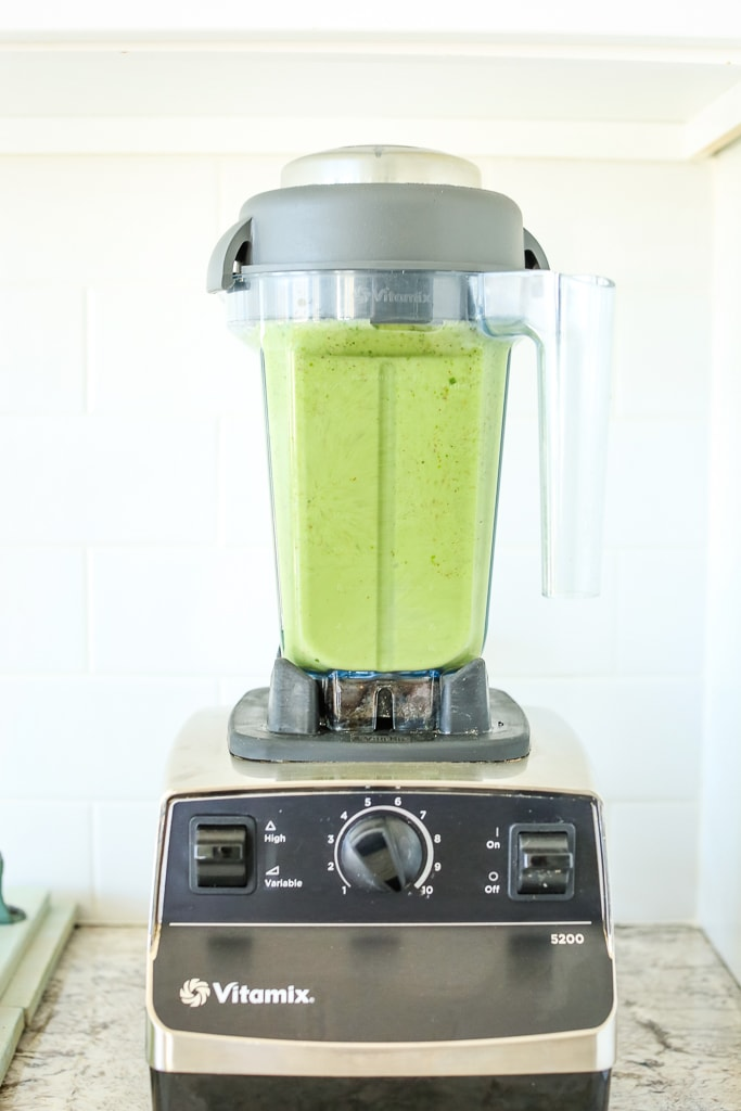a blended green smoothie in the blender