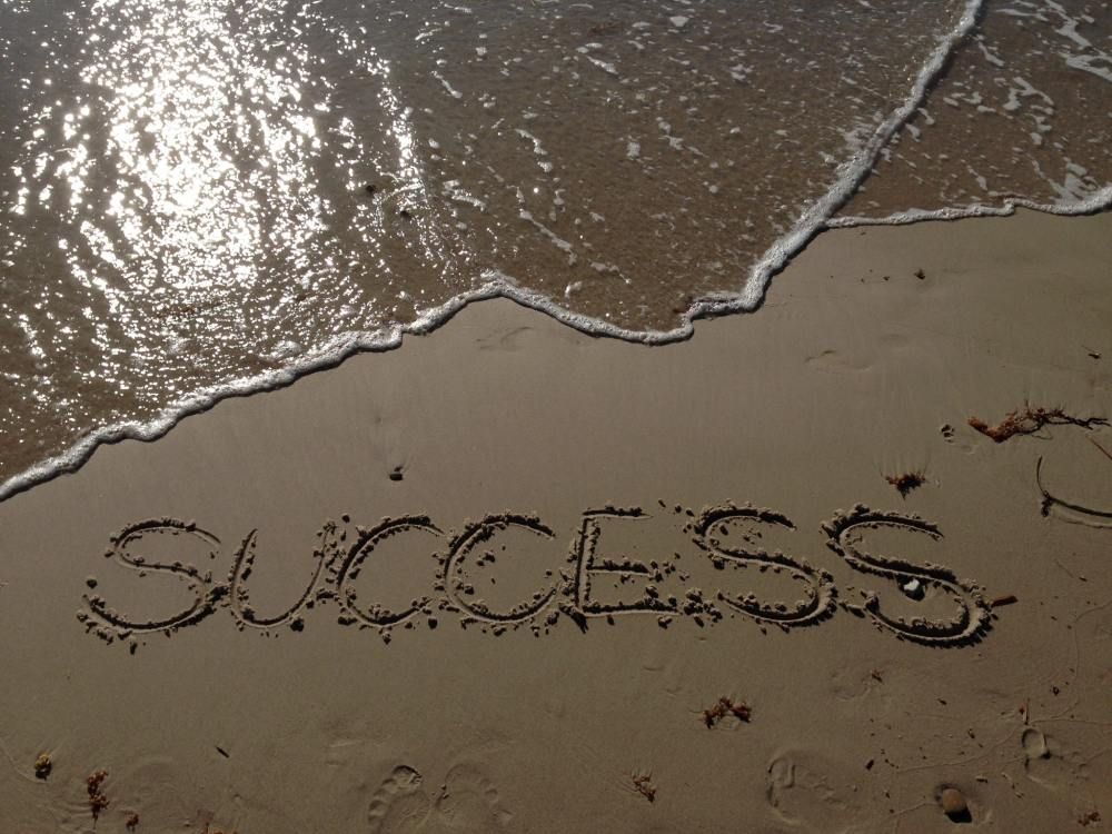 Sand with Success Written in it