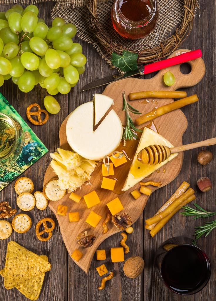 Healthy Snacks Including Grapes, Cheese, Crackers, Honey, and Nuts