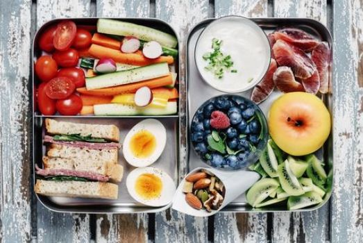 Healthy Lunch with Fruits, Vegetables, Egg, and Sandwich for Lifestyle Change