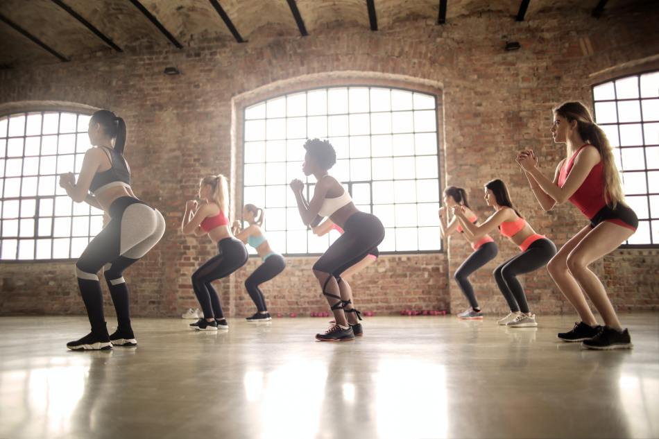 Benefits Of Squat Exercises- Women Squatting- How Many Squats to Get The Benefits