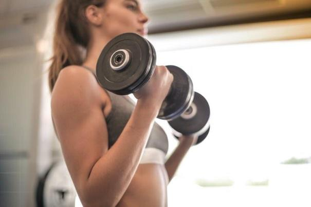 Woman Doing Dumbbell Curls - How To Lift Weights At Home