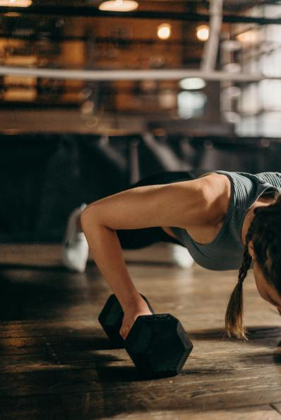 Woman Doing Push Ups - How To Lift Weights At Home