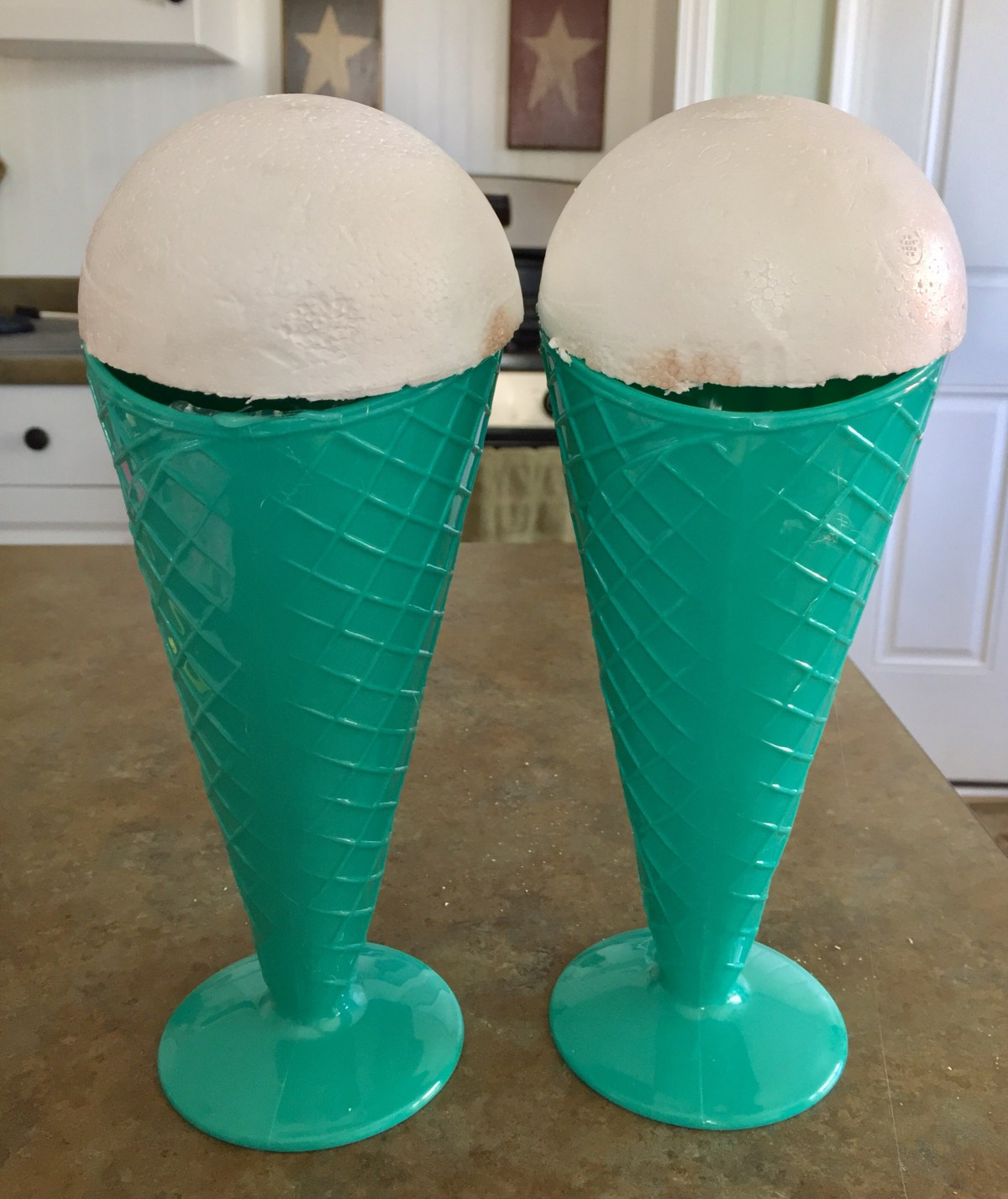 Styrofoam ball cut in half sitting on top of milkshake cups. #taffymilkshake #candymilkshake #valentinesday #icecreamsocial #icecreambirthday