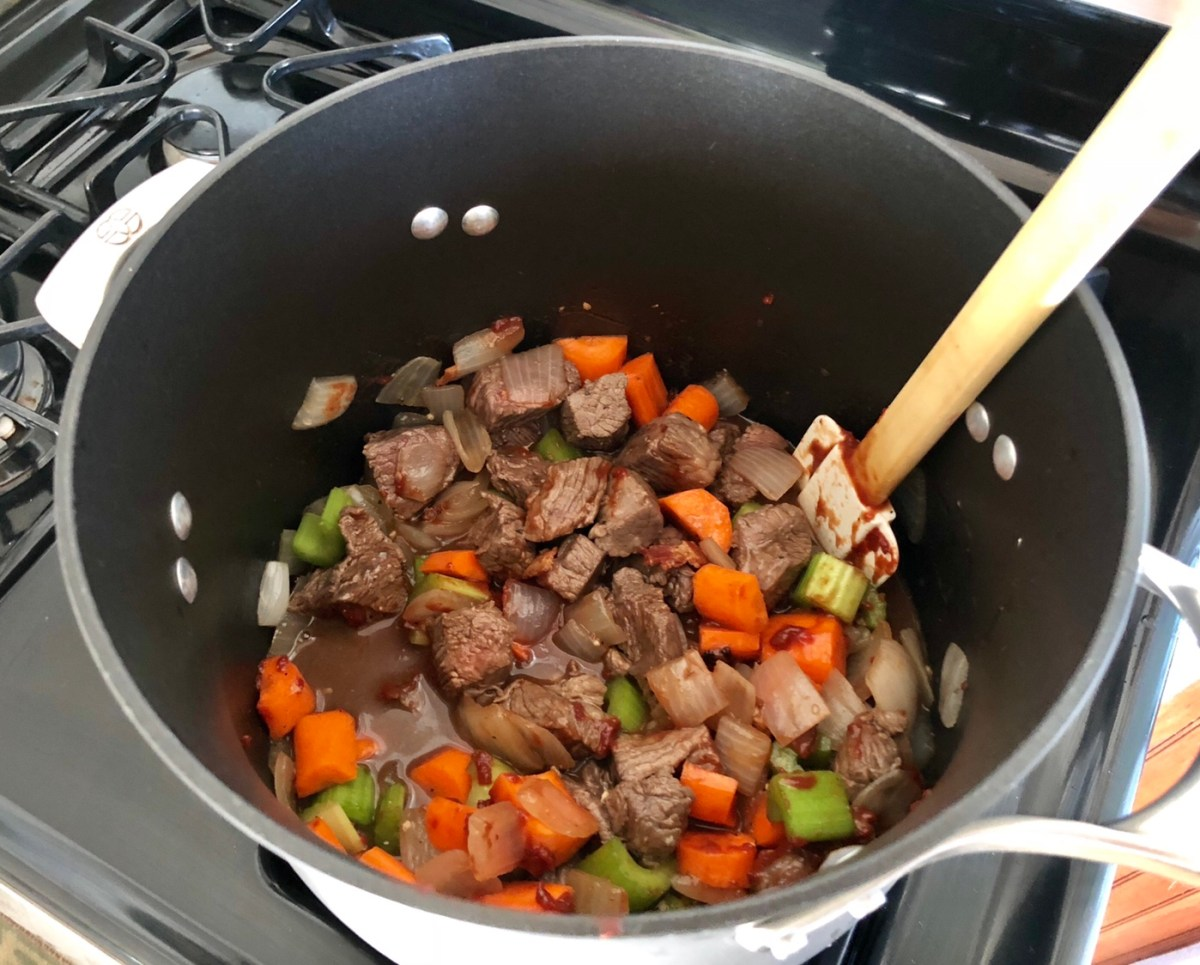 Pour the liquid into the soup pot. Stir in tomato paste, carrots, celery, thyme sprigs, sugar, and 1/2 teaspoon of pepper.