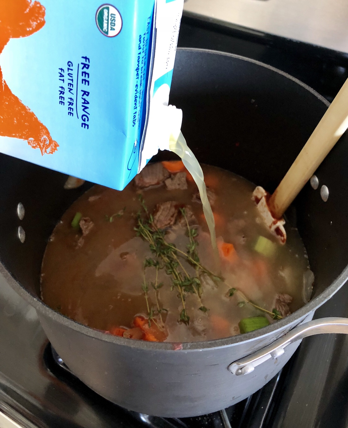 Add in 2 and a half cups of chicken broth or enough to cover. Cover and simmer for 2 hours. Uncover and boil for 15-20 minutes or until thickened.