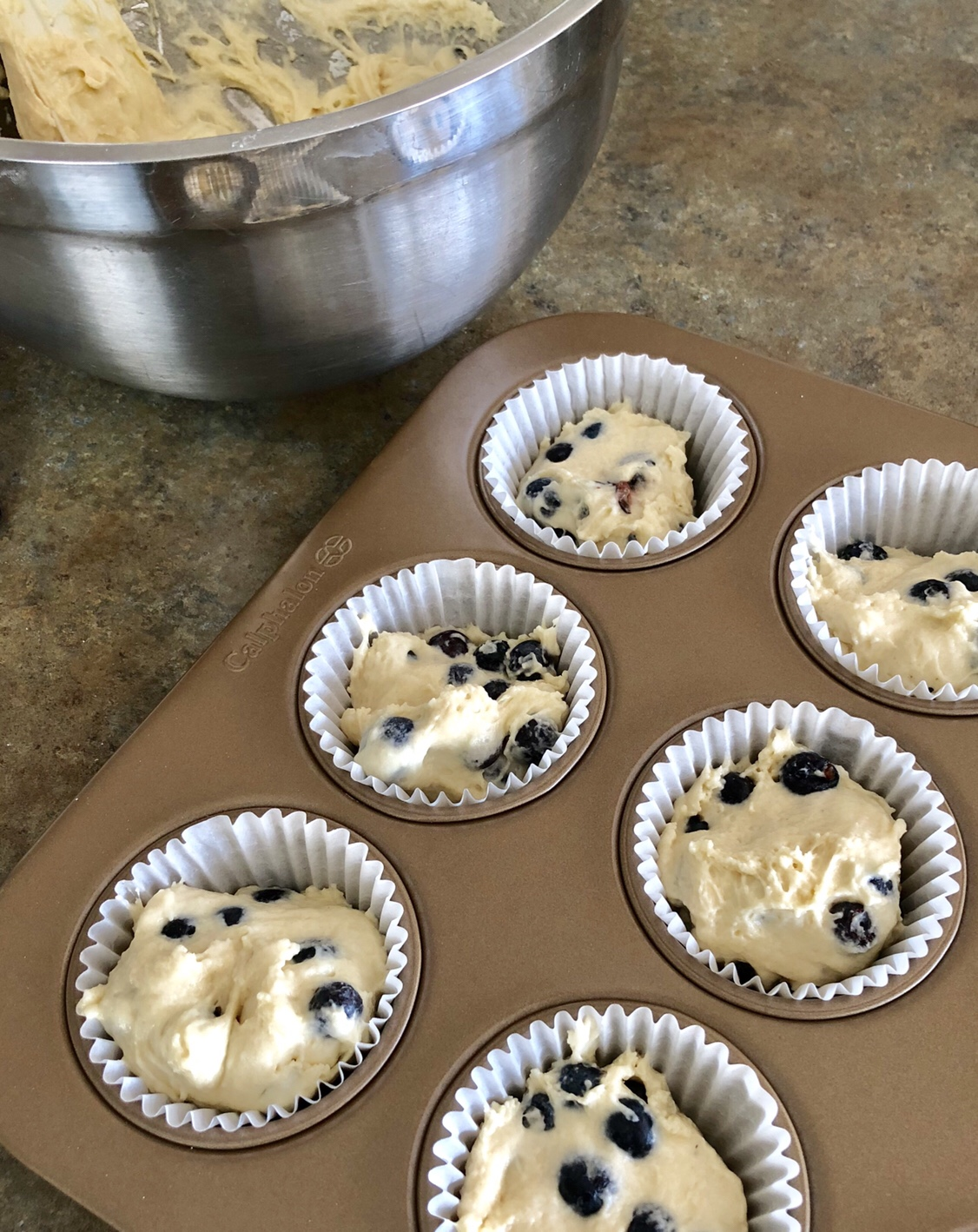 Fill a muffin pan with 12 paper-lined baking cups. Spoon the batter into each baking cup filling 2/3 of the way full.