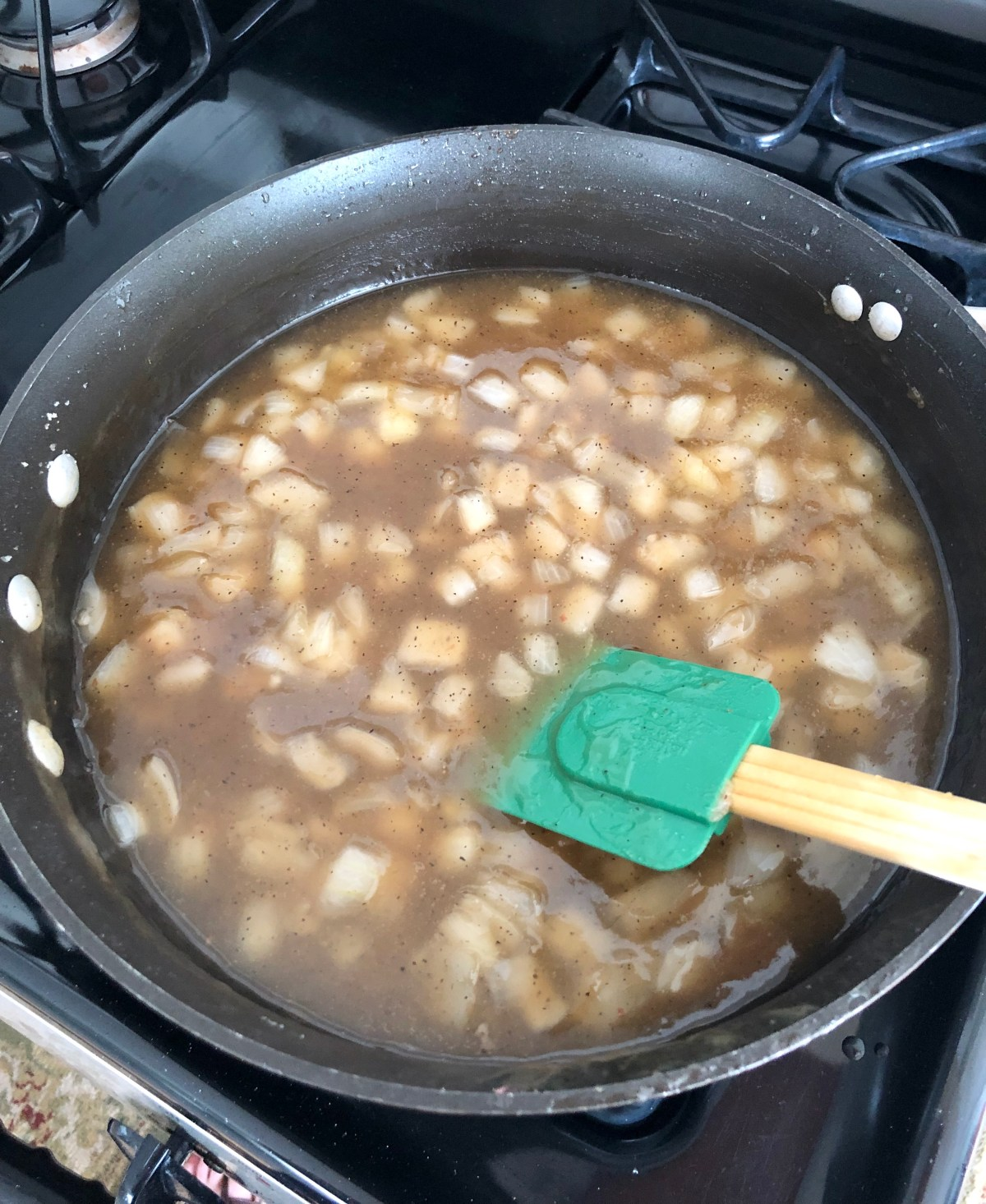 Water and apple cider vinegar are added to the skillet to form a sauce.