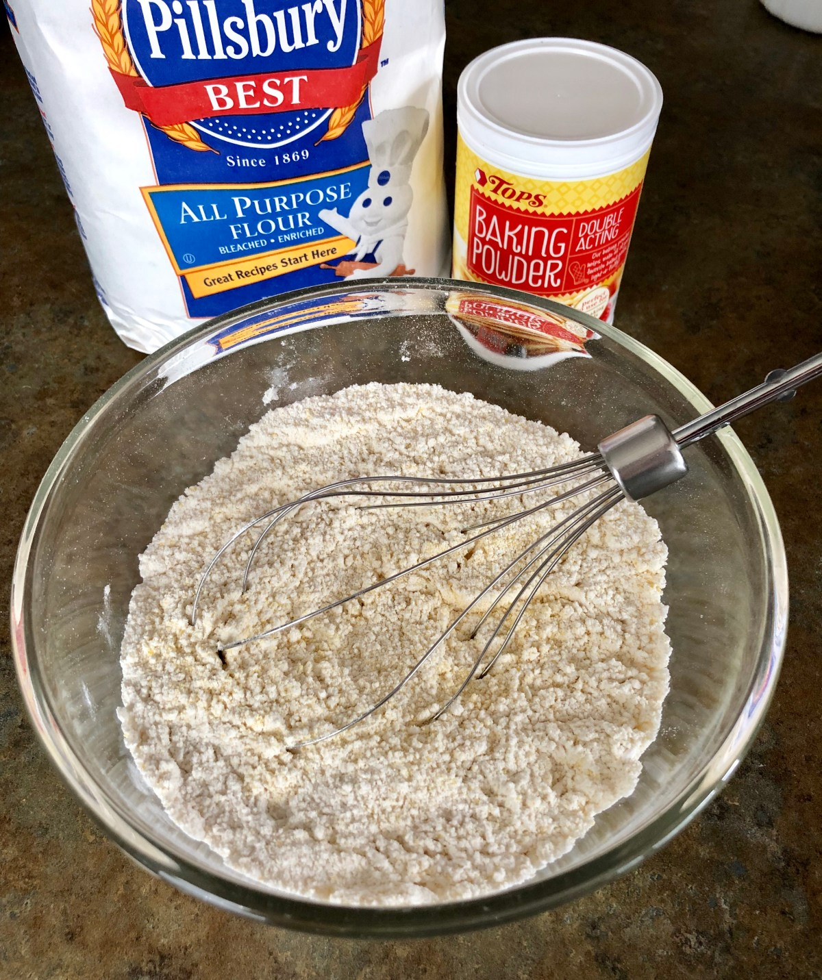 Flour, cornmeal, baking powder, sugar, and salt mixed together in a large bowl.