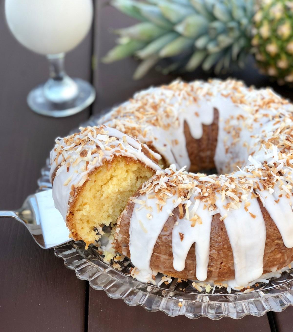 Pina Colada Cake by Happylifeblogspot.com #pinacolada #bundtcake #pinacoladacake #summerdessert #cakemixrecipes #coconutcake #pineapplecake