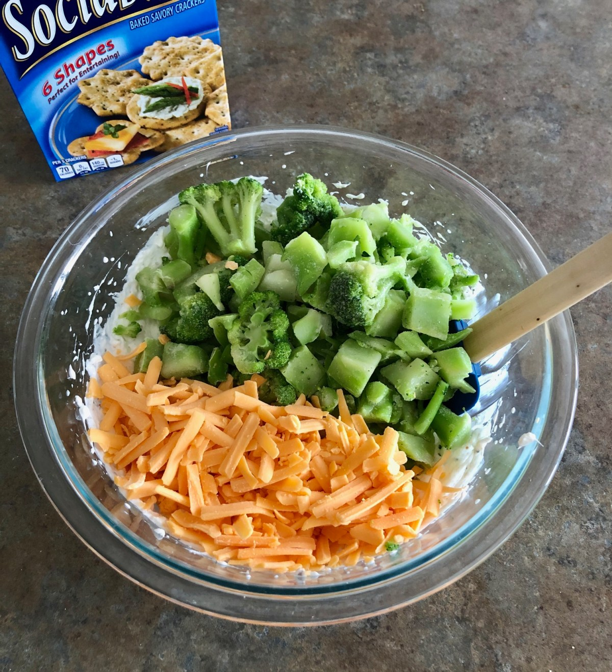 Chopped broccoli florets and shredded cheddar cheese are folded into the Broccoli Cheese Spread.