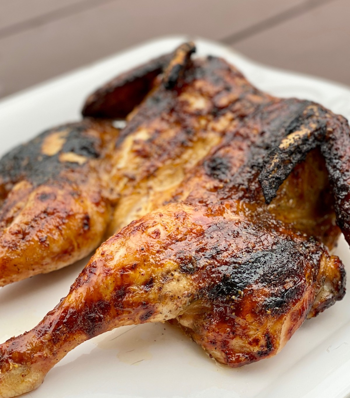 Grilled Spatchcocked Chicken by Happylifeblogspot.com #grilledspatchcockedchicken #spatchcock #spatchcocked #howtospatchcockachicken spatchcockedchicken #grilledchicken #howtogrillawholechicken #grillrecipes #dinnerrecipes #chickenrecipes #chickenonthegrill