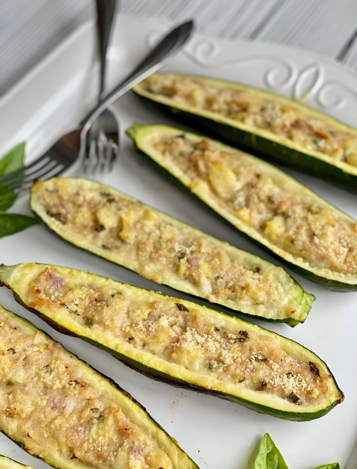 Grilled Stuffed Zucchini by Happylifeblogspot.com #grilledzucchini #grillrecipes #healthyrecipes #lowcarbrecipes #zucchinirecipes #meatless #stuffedzucchini #