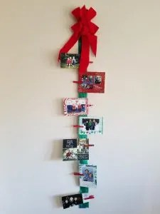 Christmas Cards Displayed on a Ribbon with Clothespins