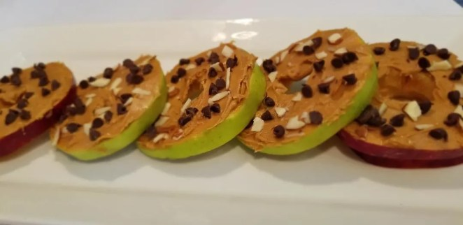 Healthy & Easy Snacks for Kids. Apple slice cookies are fun to make and can be adjusted to your families taste. Whip these up for after school snacks or late night snacks after games & activities. They would even be great snacks for a kids party. Kids will love them and you'll feel good feeding it to them. #snacks #kidsnacks #apple #healthysnack