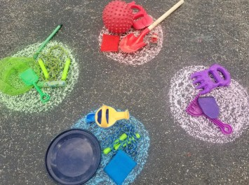A fun chalk game - Color Search. Kids can search for items to match the color in the circle around their house.
