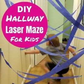 Easy DIY Hallway Laser Maze for Kids. Fun indoor activity for kids on cold or rainy days. If you stuck inside this is the perfect energy busting game for kids. Find out how simple it is to make a laser maze with streamers & tape. #lasermaze #hallwaymaze #rainyday #indoorgame #indooractivites #kidsactivities #obstaclecourse