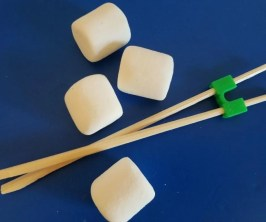 How to Play the Marshmallow Stack Minute to Win It Game for Parties with chopsticks.