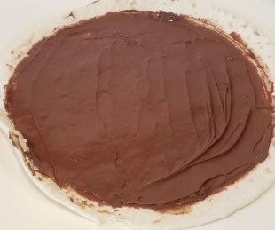 Spread Nutella or peanut butter on a tortilla  for this fun snack.