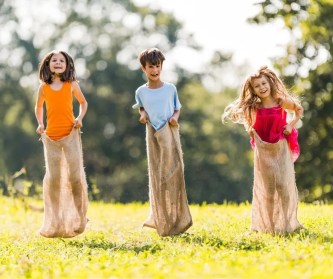 Sack Races are a fun Outdoor Party Game for Kids for backyard birthdays.