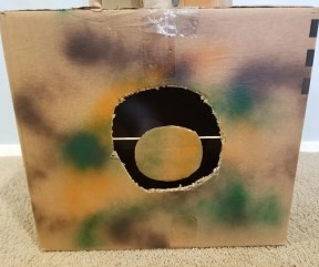 DIY Cardboard Nerf Target cut out of a camouflaged box. Cool spinning nerf target the kids will love playing with at home.
