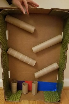 DIY Marble Run Ideas with Cardboard. Create this cool STEM experiment at home using cardboard tubes, boxes and glue. Then recorded your observations on a free printable chart. A fun cardboard challenge at home.
