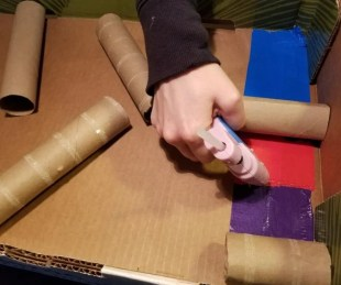 Use hot glue to make a Cardboard Marble Run. A fun cardboard challenge at home.