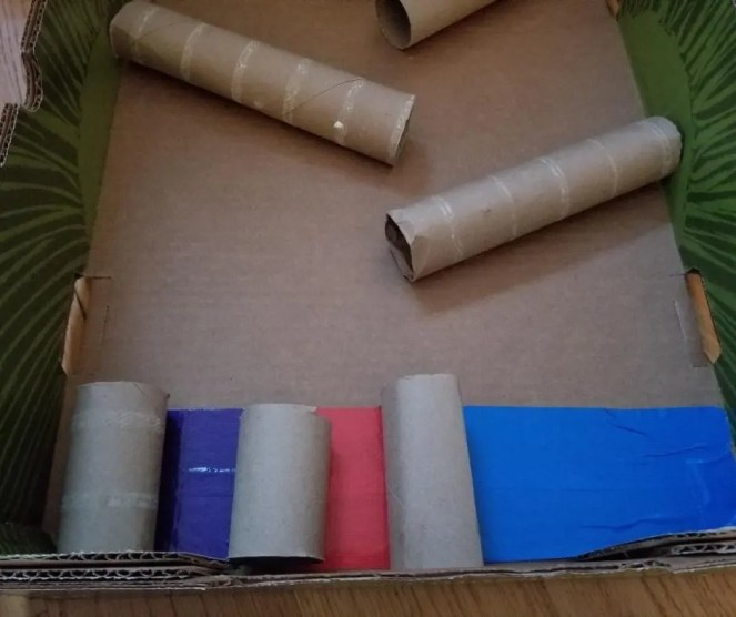 Marble Run Set up with tape and toilet paper rolls