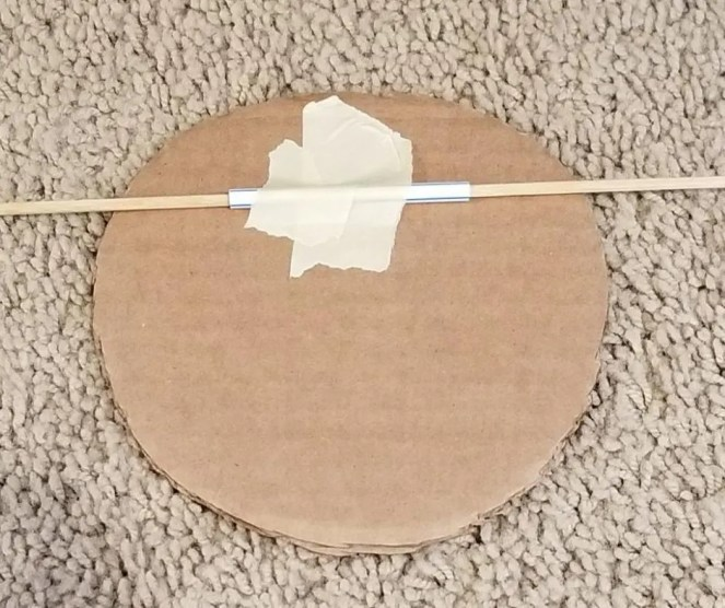 Tape a Straw to Your Cardboard Spinner to create you Cardboard Nerf Target