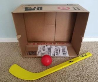 Indoor Cardboard Box Hockey for Kids. Play indoor hockey by using a cardboard box and hockey sticks. Keep your kids active when your stuck indoors.