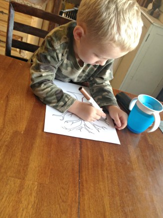 Ranger coloring his tree in