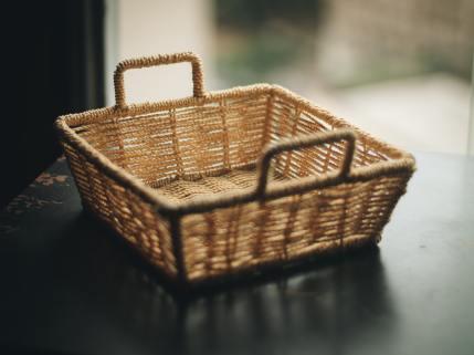 square-brown-wicker-basket-on-table-2113125.jpg