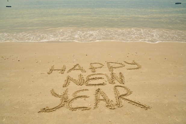Happy New Year Celebrations On Beach Sand