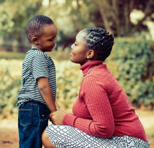 Experieince fewer challenging behaviors, with less frequency and less duration through parent coaching