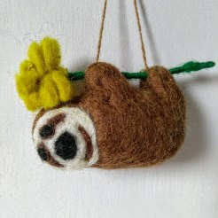 felt brown sloth with flower