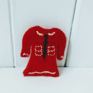 red dress brooch