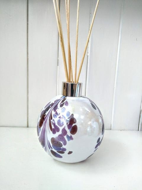 white purple round diffuser