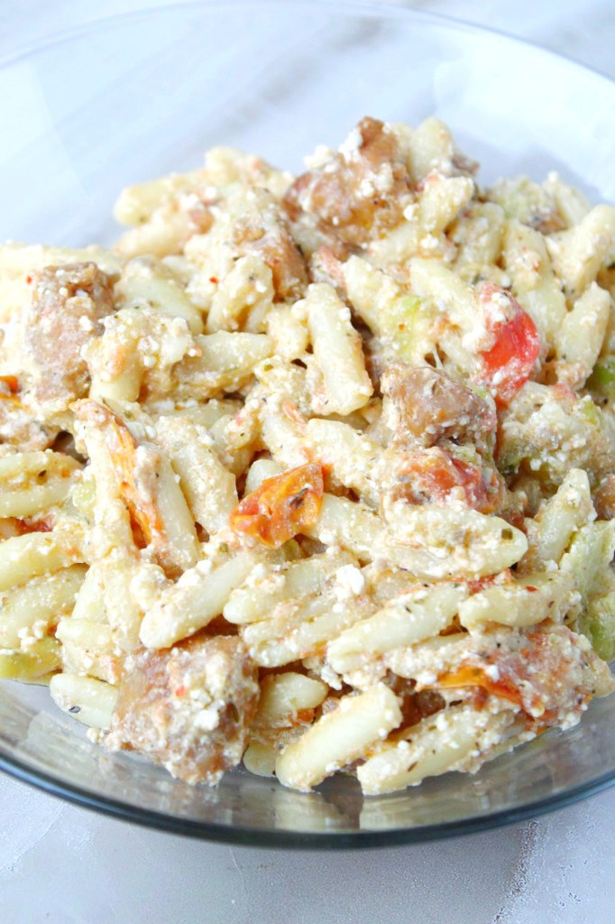 The viral baked feta pasta with extra veggies and protein - Delicious, simple, and quick! This amazing baked feta pasta with zucchini and chicken sausage will be your new favorite pasta!