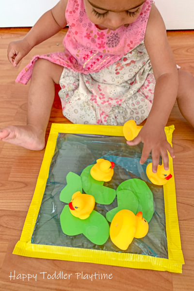 Pretend play activity with rubber ducks for toddlers
