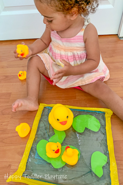 Pretend play sensory bag activity with rubber ducks for toddlers