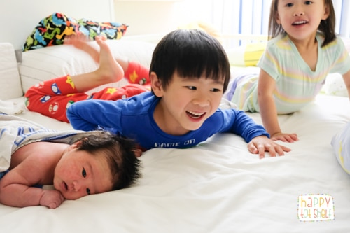 3 young children playing together