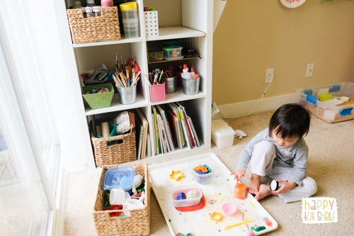 Young child playing with play dough in homeschool room