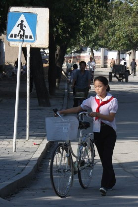 North Korea Citizen with Bike