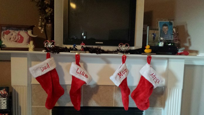 Stocking are my favorite, they always have been! The Mr. and Mrs. came from my mother in law on the night my husband and I got engaged. The kids are just plain one I hot glue whatever they are into that year on.